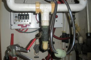 Battery Switch and circuit breakers were located behind and under galley sink.